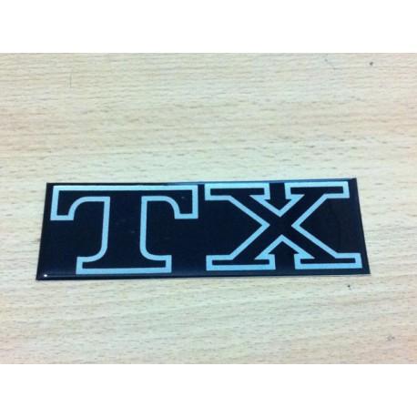 Anagrama TX esmaltado